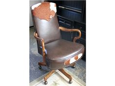 Cow hide and leather desk chair