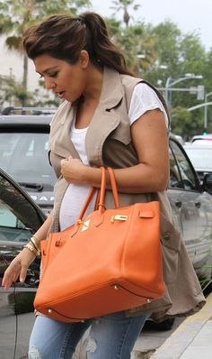 Kourtney Kardashian ... pregnant of her second child, Penelope Scotland Disick (born July 2012).