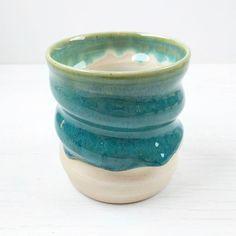 Swirly tumbler in Heath A2V. Ivory inside Persian green outside.  #pottery #clay #potteryart #potterystudio #ceramicbowls #pottery #potterymaking #instapottery #claystagram #potterylove #potterylife #pottersofinstagram #kilnfolk #ceramic #ceramics #contemporaryceramics #handmade #handmadepottery #createmakeshare #glaze #cone6 #wheelthrown
