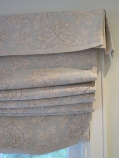 Roman shade with tailored valance - really like this; especially the fullness.
