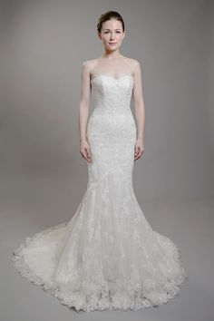 Stunning lace wedding dress that is slim fitting and flowy towards the bottom!
