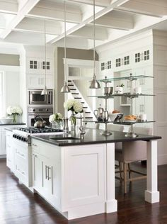 Avenue-Tan-greige-kitchen-with-white-counters-and-black-countertops.png 487×653 pixels