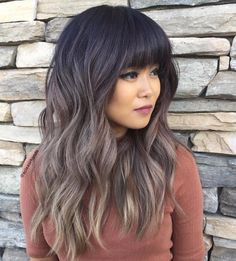 A deep brown that fades into gray-blonde is the perfect way to lighten up your hair just a *little* for summer.