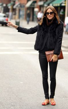 all black outfit with splashes of color in shoes & clutch