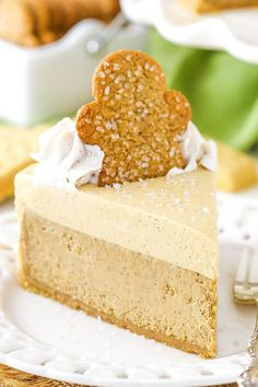 This Gingerbread Cheesecake is made with a delicious shortbread crust, gingerbread cheesecake filling and a molasses mousse topping! Perfect for the holidays!!