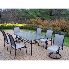 """Sling 7 Piece Dining Set Finish: Black by Oakland Living. $1499.80. 10027-10605-2S4C-7-BK Finish: Black Features: -Hardened powder coat for years of beauty.-Fade, chip and crack resistant. Includes: -Includes one dining table, four dining chairs and two swivel chairs. Construction: -Durable sling and tubular aluminum construction. Assembly Instructions: -Stainless Steel, or galvanized steel assembly hardware. Dimensions: -Overall dimensions: 29"""" H x 72"""" W x 42"""" D. Coll..."""
