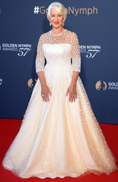 HELEN MIRREN in a cream gown with an embellished sheer overlay at the Golden Nymph Awards Ceremony during the 57th Monte Carlo TV Festival in Monte Carlo, Monaco.