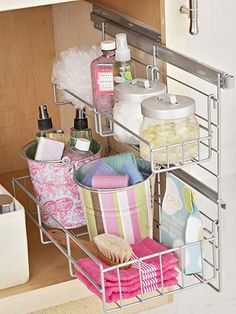 Slide Out Organization! This would be great under the bathroom sink