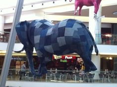 Massive elephant made of Shweshwe suspended above the food court. Using hand made decorations aids economic empowerment in the Western Cape. Food Court, South Africa, Baby Car Seats, Roots, Cape, Elephant, Decorations, Creative, Handmade
