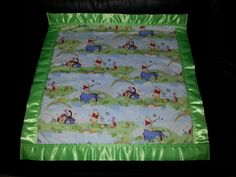 This 22 x 22 inches Cotton and Fleece blanket has the Baby Winnie the Pooh on the front 100% Cotton and the back is made from 100% Polyester Fleece with a two inch satin trim around the blanket (all our blanket trims and fleeces are 100% Polyester). We will personalize the blanket which is included in the price with the person's first name (embroidery letters are about 2 inch tall). We Guarantee Quality in our blankets. Thank you for your Business. Price $27.99 Free Shipping