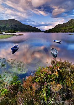 Evening view over Upper Lake and boats in Killarney National Park, Rep. of Ireland. Killarney National Park was designated as a Biosphere Reserve in 1981 by UNESCO.