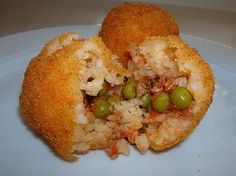 Oh man, I'm going to have to make these soon. Brings back childhood memories. Growing up in a Sicilian home, I ate some of the most delicious foods. This is 1 of them. Arancini (rice balls) http://vittoriagourmet.blogspot.com/2011/05/arancini-italian-rice-ball.html
