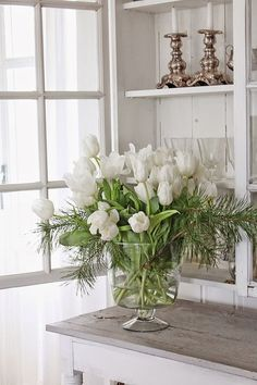 Beautiful floral bouquet for the holidays #whiteflowers #holidaybouquet White Tulips, Floral Arrangements, Vases, Flower Arrangements, Flower Arrangement, Jars, Bouquet, Vase, Floral Centerpieces