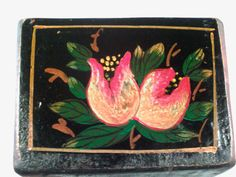 This is a beautiful vintage Tole painted, handmade wood planter box from the first half of the 20th century. European origins. Made so perfectly, its practically seamless. A black background with vibrant red and yellow hand painted fruit and flowers in varying stages of bloom or