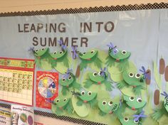 """End of year bulletin board...""""Leaping into Summer"""" with frogs and dragonflies on lily pads with cat tails."""