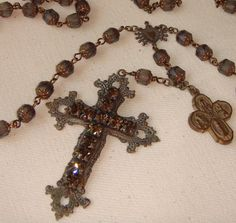 Smoke Brown Color Beaded Rosary Style Necklace with Cross.  $235.00