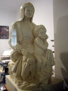 This is a replica of the Michelangelo sculpture made of white chocolate