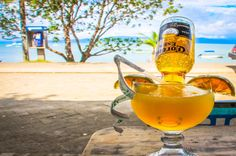 Margarita Corona, three ounces of tequila, one ounce of triple sec, lime, two splashes of orange juice, ice and one corona placed upside down in a wide brim glass. Marisqueria Corcovado Puerto Jimenez, Puntarenas Costa Rica #seafood #restaurant #review #yum #foodie #food