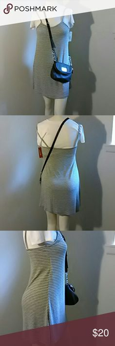 Gray and white ribbed t-shirt dress Built in tee with ribbed dress, comfort and cute all in one.  Quick errands or a day shopping pair with your favorite converse or flops and go. This falls above the knee on my manican that is 5'4. Dresses Midi
