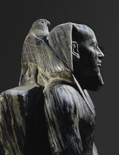 Diorite statue of ( Khafre, Khefren, Chephren) on his throne with a falcon on his shoulder. Son of Khufu and a king of the fourth Dynasty. Builder of the second largest pyramid of Giza. Although highly disputed, some Egyptologists credit him with the building of the Great Sphinx.