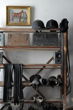 great idea for the tack room - a row of helmets, a row of boots, and then plenty of room for clean saddle pads and girths