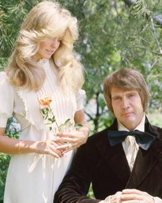 Just 'cause it's nostalgic and such: Farrah Fawcett In White Dress Looking Down At Lee Majors In Tuxedo