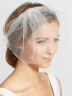 This classic blusher veil adds a touch of airy romance to your wedding look. The bejeweled comb creates the perfect wedding day sparkle to whatever hairstyle you choose. | Crystal Comb Tulle Blusher Veil