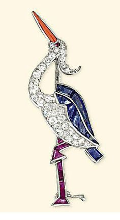 AN ART DECO SAPPHIRE, DIAMOND AND RUBY BROOCH  Modelled as a heron, pavé-set with circular-cut diamonds to the calibré-cut sapphire wings, ruby legs, coral beak and circular-cut ruby eye, circa 1925, with French assay marks for platinum, 4.5cm high