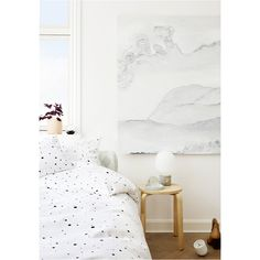 Clean and sophisticated bedroom. Love the white bed sheets with black dots. Way more fun than plain white sheets.