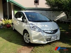 """Honda, Fit Hybrid GP1, Navi Premium Selection, 2011 2011/06, 7425KM, Pearl White, Navi Premium Selection, Original 15 inch Alloy Wheels Original DVD/Navigation System and Reverse Cam, Bluetooth, Puncture Repair Kit, Auction Grade: """"5"""", """"A"""", """"A"""", Auction sheet and JAAI available for inspection, * 2Year / 40,000KM battery pack warranty can be given for additional cost @ Rs 100,000/-(conditions apply) * VAT available, Rs 3,825,000/-, Phone: 0770473622 (Negotiable after inspection) Honda Fit Hybrid, Alloy Wheel, Pearl White, Cars For Sale, The Selection, Fitness, Cars For Sell"""