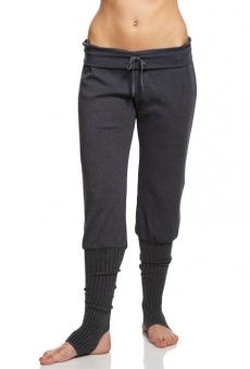 Relax fit dance pant with wide drawstring waistband and integral rib knit stirrup legwarmers. 50% cotton 50% polyester.