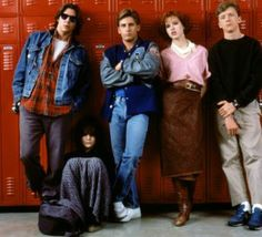'The Breakfast Club' crew in their 80s attire including high rise denim jeans, patterned shirt and below the knee leather skirt.