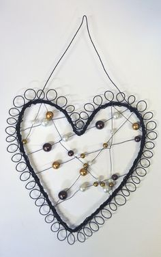Love the wire and bead work, could possibly make this...