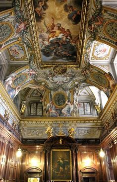 """Sant' Andrea al Quirinale, Rome.  The Sacristy is through a door to other right of the high altar.  The altarpiece depicts the """"Immaculate Conception"""" by Andrea Pozzo.  The spectacular frescoed ceiling vault depicts the """"Apotheosis of St. Andrew"""" and is by Giovanni de Brosse."""