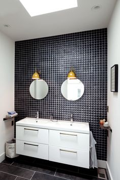 Bathroom in the Portland, Ore., house of Brian and Jill Faherty of Schoolhouse Electric & Supply Co. Ikea cabinets, Schoolhouse brass pulls and light fixtures, Pillow tile from Ann Sacks. Small Bathroom Shelves, White Bathroom Tiles, Yellow Bathrooms, Master Bathroom, Ikea Bathroom, Bathroom Ideas, Small Cabinet, Bathroom Mirrors, Washroom