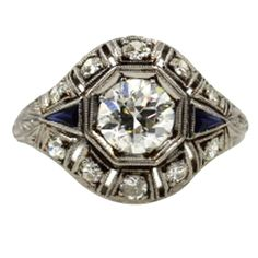 Original Art Deco Diamond Platinum Ring With Accent Sapphires | From a unique collection of vintage engagement rings at https://www.1stdibs.com/jewelry/rings/engagement-rings/