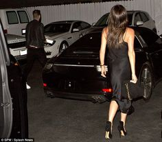 Let's eat: Victoria looked elegant in a black evening dress as she made her way across the...