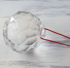 This is a large 50mm clear crystal on traditional red feng shui cord.  When hung in windows, crystals can bring chi energy in from the outside into dark areas of your home. If the crystal is placed in the south-east, north-west, or center of a room can aid in stimulating prosperity/wealth.