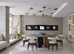 60 Modern Dining Room Design Ideas   See more at http://www.bocadolobo.com/en/inspiration-and-ideas/modern-dining-room-design-ideas/   #ModernDiningRoom #DesignIdeas #diningroomdesignideas #diningroom #diningarea #lighting #seating #neutral #colorschemes #furnituredesign #ebook #luxury