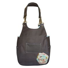 Abbey Lou leather shoulder bag with adorable flower. Great for going back to school and making a fashion statement.