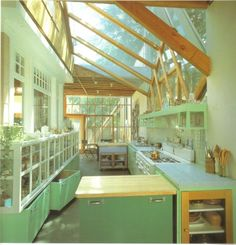 Greenhouse Kitchen. [I like this one, and I also like the beautiful Craftsman kitchen shown 4th from the bottom in the article. And the one with the brick floor.]