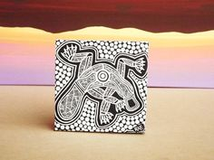A small canvas block ready to hang on your wall. Modern and Traditional Aboriginal black and white Line Art and Earth Colour Dot Art design mixed