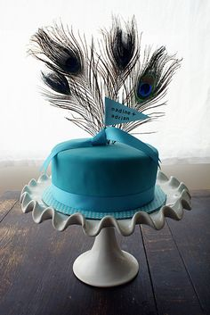 A blue beauty cake with peacock feathers