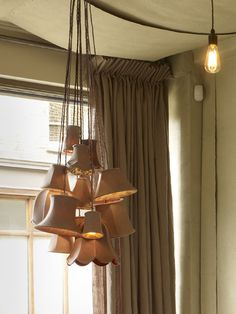 Clustered lamp shades and swagged ceiling. Yup and Yum.