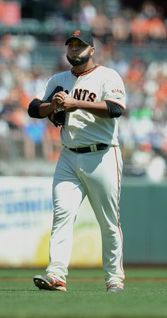 The San Francisco Giants' Yusmeiro Petit (52) takes a walk after setting a Major League consecutive outs record against the Colorado Rockies in the third inning of their MLB game played at AT&T Park in San Francisco, Calif., on Thursday, Aug. 28, 2014. (Dan Honda/Bay Area News Group)