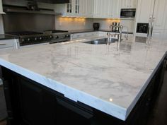 White Granite countertops & Marble countertops are very popular in Chicago and all over the United States. White granite countertops are beautiful and in de Grey Granite Countertops, Outdoor Kitchen Countertops, Kitchen Countertop Materials, Kitchen Backsplash, Granite Kitchen, Gray Granite, Backsplash Ideas, Countertop Options, Kitchen Cabinets