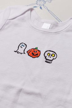"This is Halloween on a onesie/T-shirt! Tiny icon's of Halloween are screen printed by hand on this piece. A sweet and unique item for your baby or child.    This soft, 100% cotton body suit or t-shirt is available on white or gray onesie or t-shirt. Made to order just for you. If you'd like your skull or ghost eyes a different color, message me and I can make it whatever color you'd  like!    A Printed Matter Ink original design, hand silk screened by me in my studio.  Design measures 1.0""…"