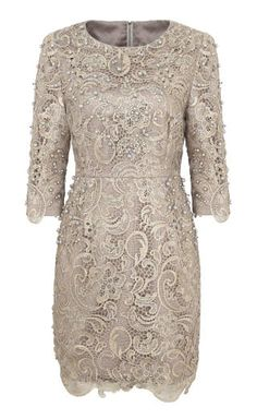 Don't shy away from mini dresses for weddings, just keep the neckline high and the sleeves long.