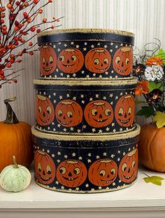 1930's Halloween bandboxes.. look out for paper tablecloths to mod podge onto paper mache boxes.
