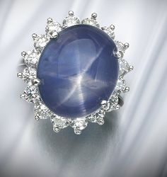 Star sapphire and diamond. In this ring a cabochon star sapphire is surrounded by brilliant-cut diamonds. Sapphire Color, Sapphire Diamond, Princess Diana Engagement Ring, Gem Diamonds, Fine Jewelry, Jewellery, Vintage Jewelry, Bling, Jewels